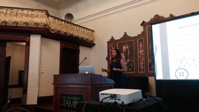 Dr. Romero-Hall presenting in the Music Hall.