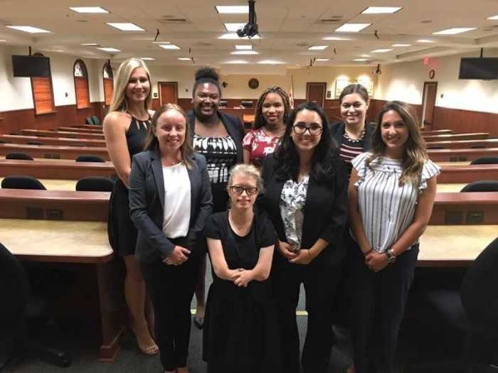 Eight UT Honors students at the Inn of Court in the main courtroom at the 2nd DCA